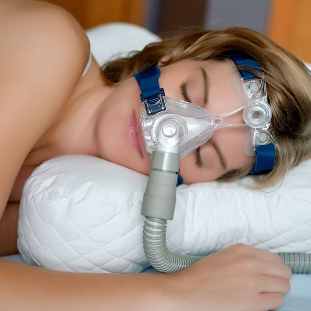 woman wearing nasal mask for cpap